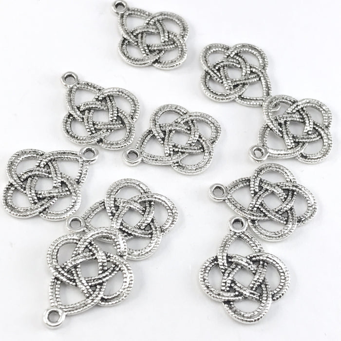silver colour jewerly charms shaped like celtic knots