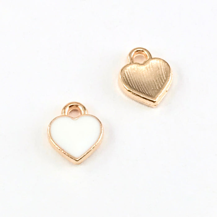 front and back of white and gold heart shaped jewelry charms