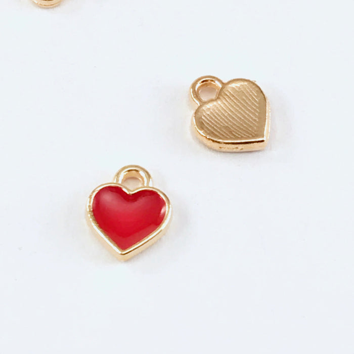 front and back of red and gold heart shaped jewelry charms