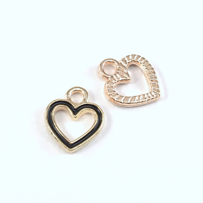 front and back of black and gold colour heart shaped jewelry charms