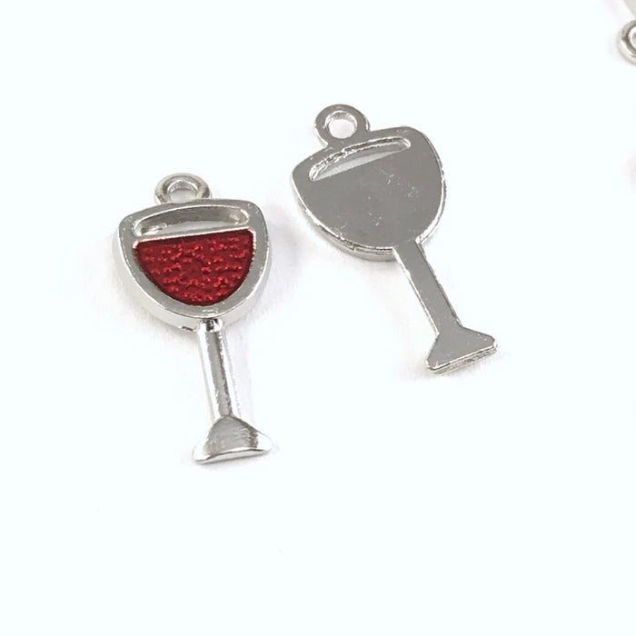 front and back of red and silver jewerly charms that look like glasses of red wine