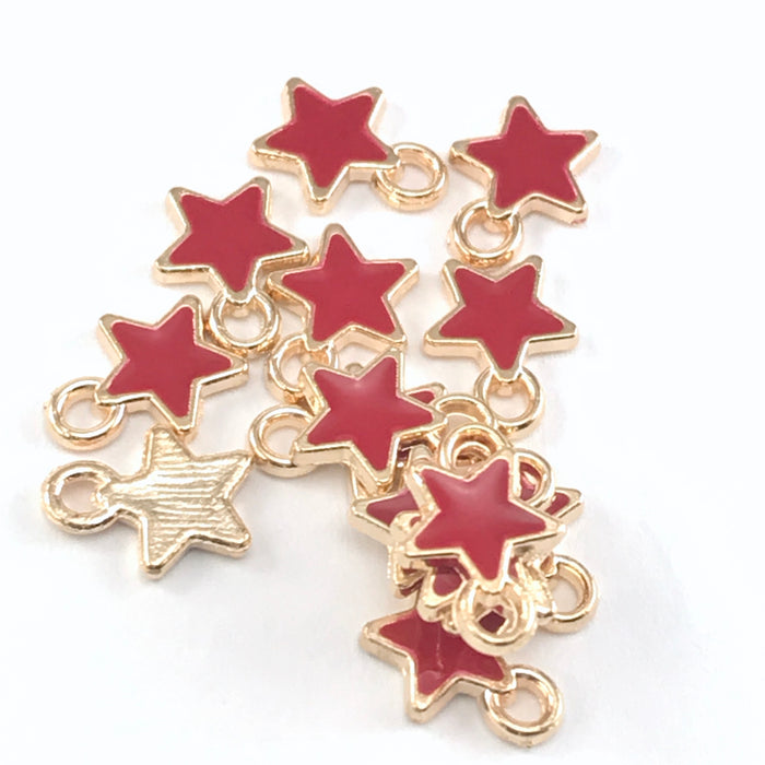 15 star shaped jewelry charms that are red and gold