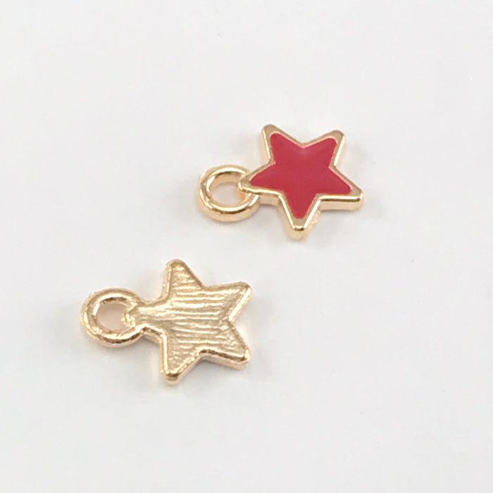 front and back of star shaped jewelry charms that are red and gold