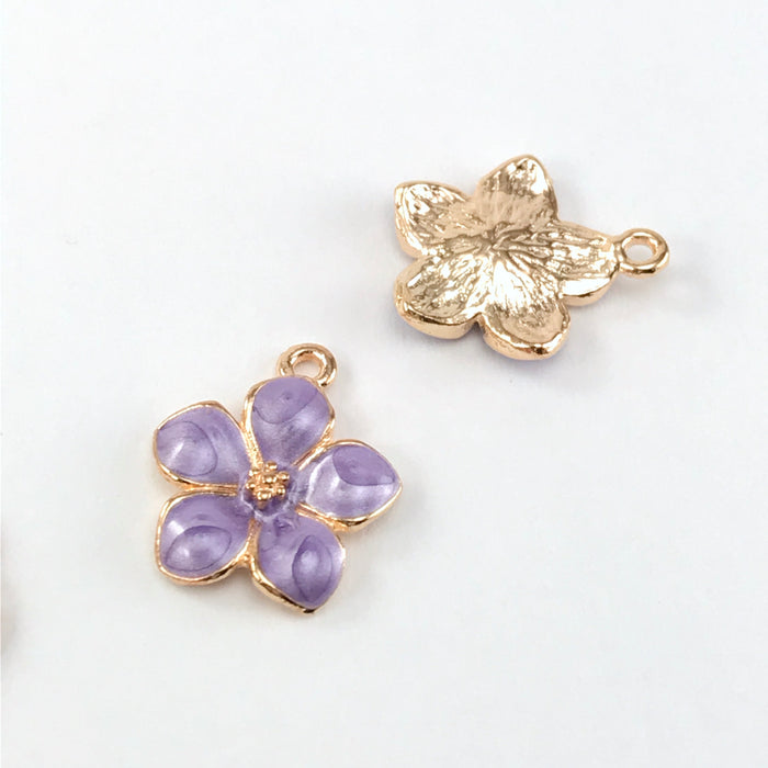 front and back of jewelry charms that look like purple and gold flowers