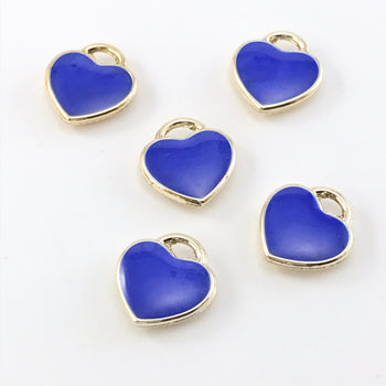 blue and gold jewely charms that are heart shaped