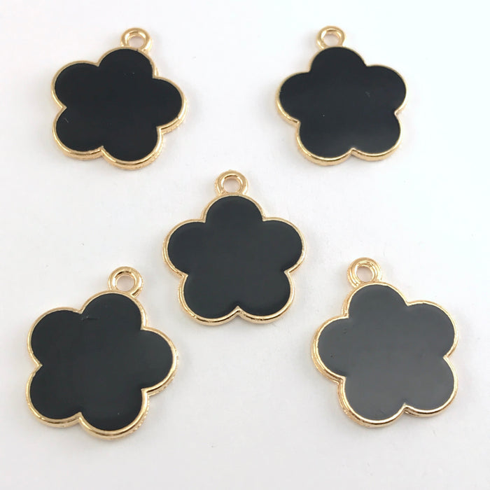 black and gold jewerly charms shaped like flowers