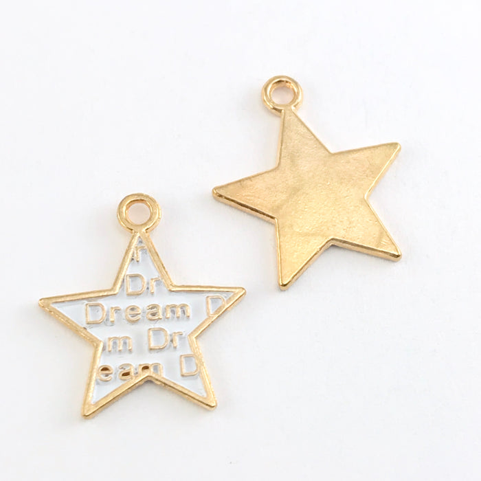 front and back of white and gold star shaped jewelry charms with the word dream on them