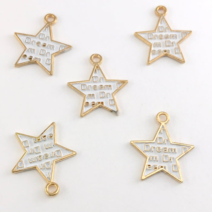 white and gold star shaped jewelry charms with the word dream on them