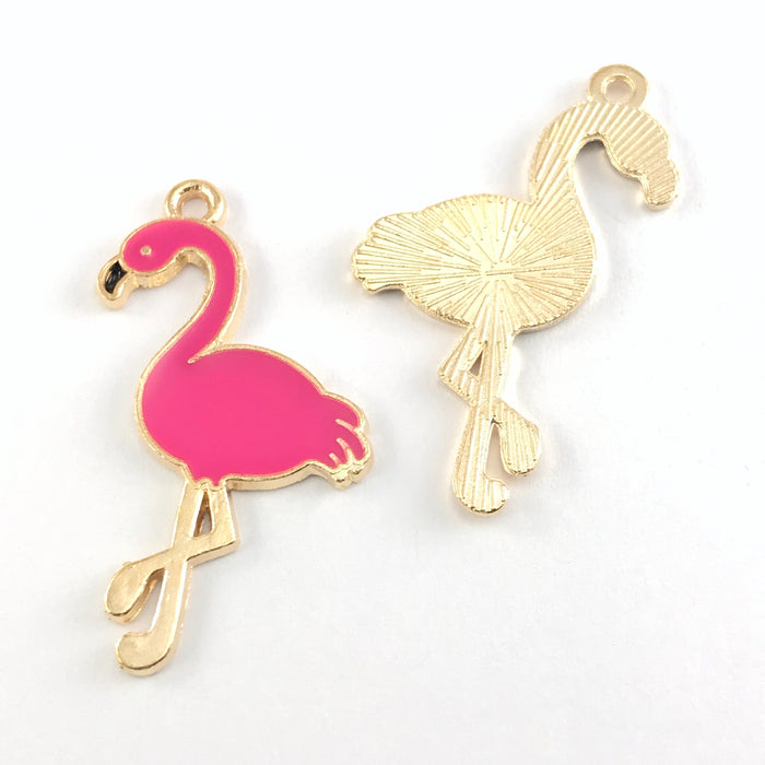 front and back of pink and gold jewelry pendant charms that look like flamingos