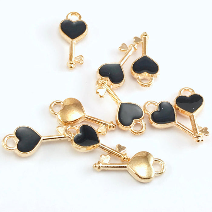 10 key shaped jewelry charms that are gold and black colour