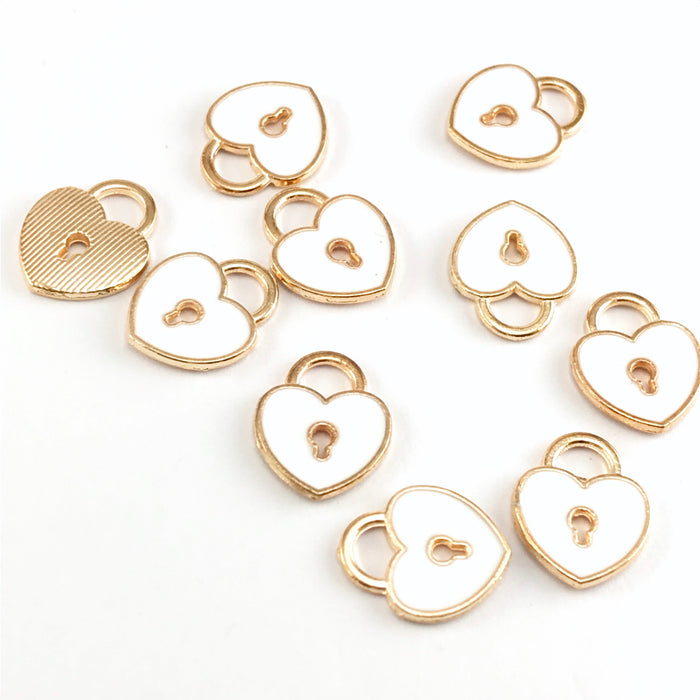 white and gold colour jewelry charms that are shaped like locks with a keyhole