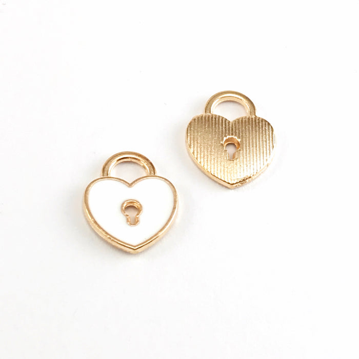 front and back of white and gold colour jewelry charms that are shaped like locks with a keyhole