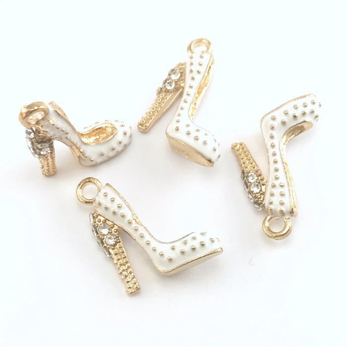 4 white and gold colour jewelry charms that look like shoes