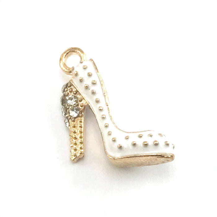 close up of white and gold colour jewelry charm that looks like a high heeled shoes