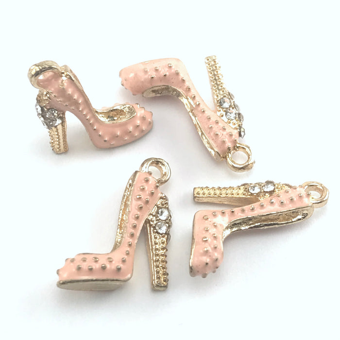 pink and gold colour jewerly charms that look like high heel shoes