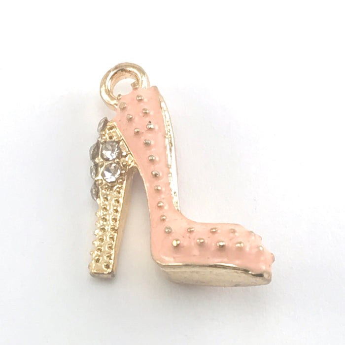 close up of pink and gold colour jewerly charms that look like high heel shoes