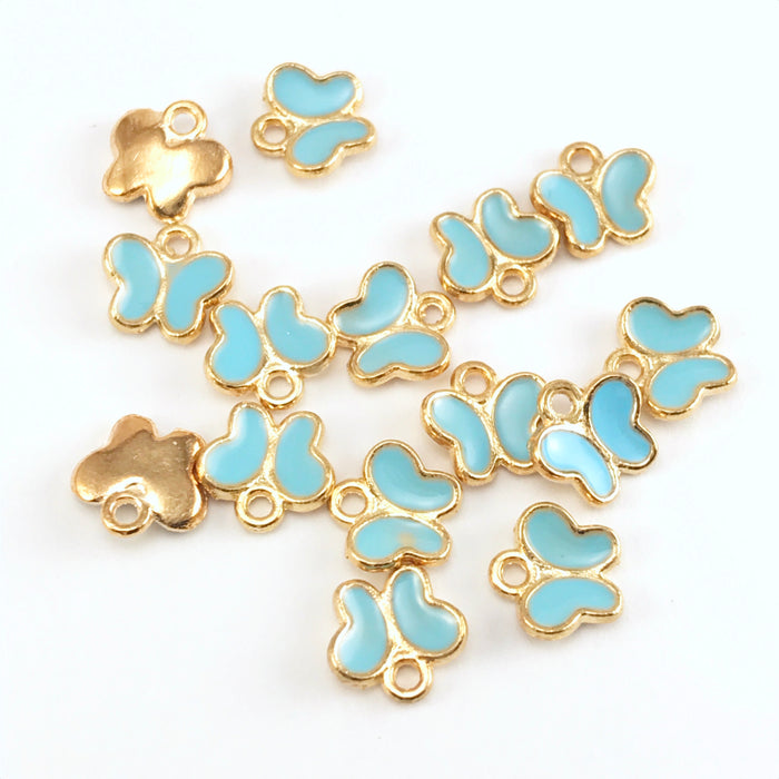 blue and gold colour jewerly charms that look like butterflies