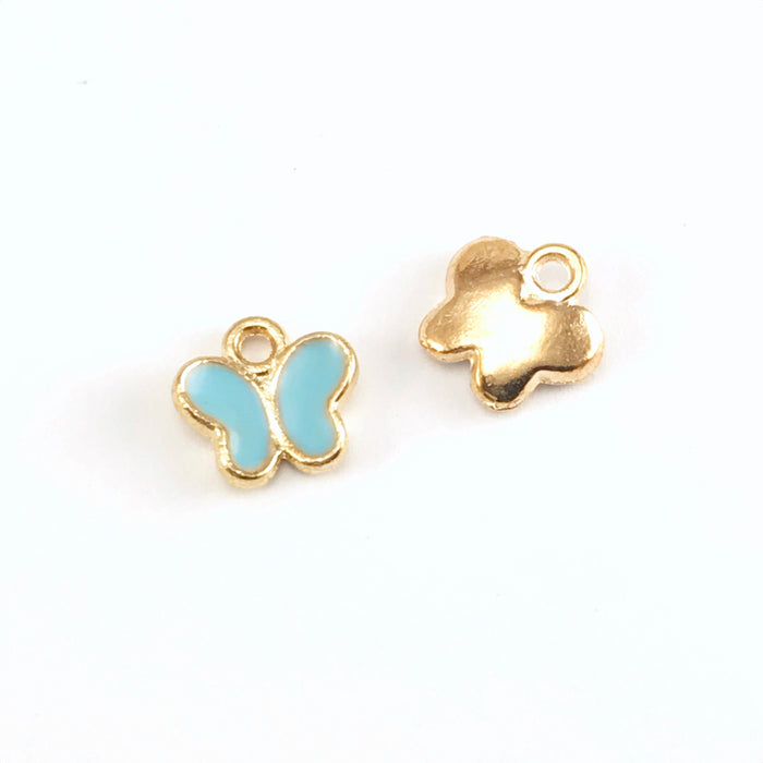 front and back of blue and gold colour jewelry charms shaped like butterflies