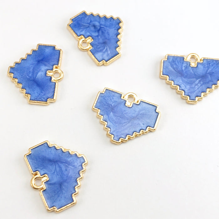 blue and gold jewerly pendants that are heart shaped