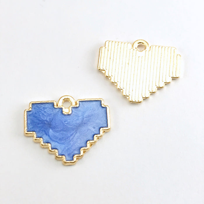 front and back of blue and gold jewerly pendants that are heart shaped