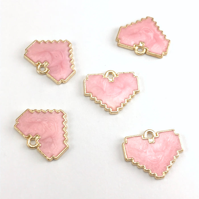 pink and gold jewelry pendants that are heart shaped