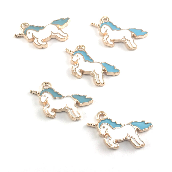 white blue and gold colour jewerly charms that look lke unicorns