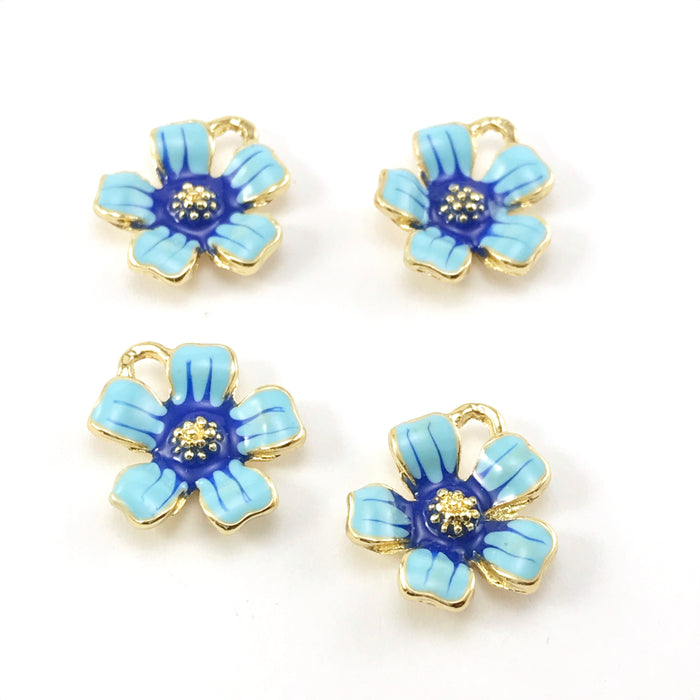 flower shaped jewelry charms that are gold, light blue and dark blue