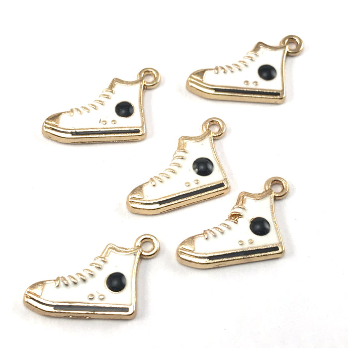 white and gold colour jewelry charms that look like high top running shoes