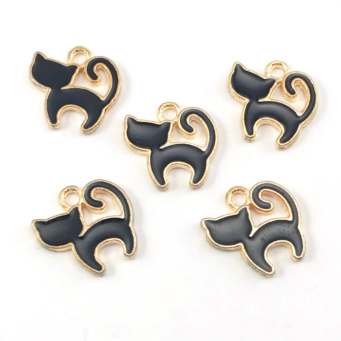 5 black and  gold colour jewerly charms that look like cats