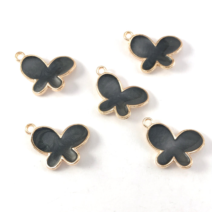 black and gold colour jewerly charms shaped like butterflies