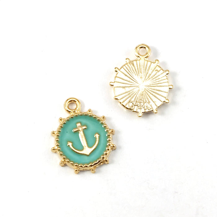 front and back of green and gold jewelry charms that look like anchors
