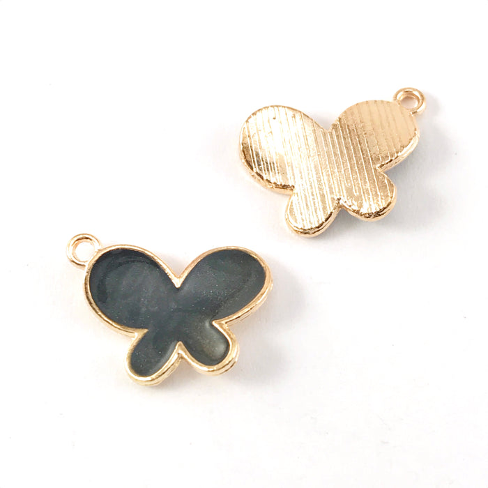 front and back of black and gold colour jewerly charms shaped like butterflies
