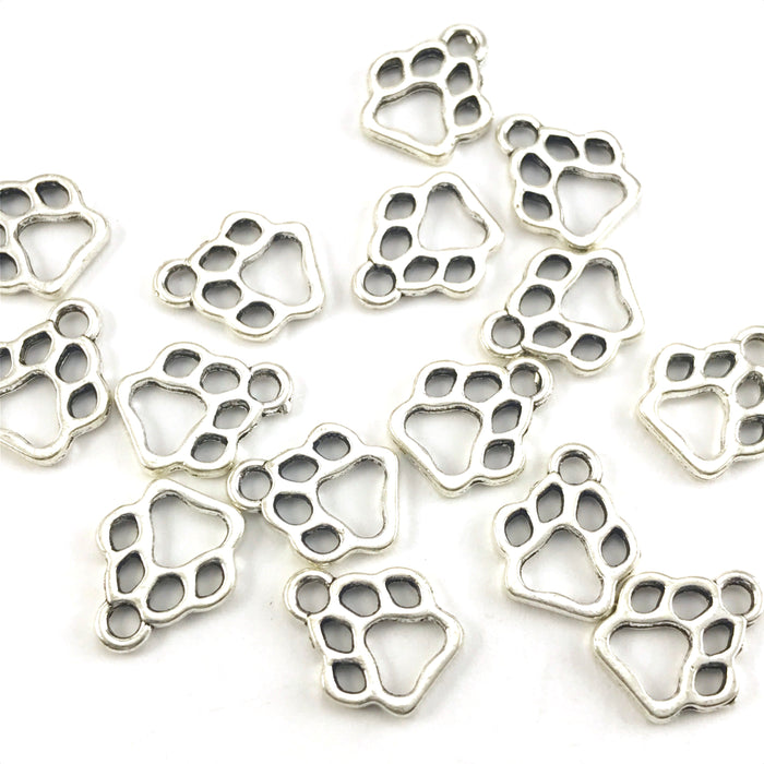 silver colour jewelry charms shaped like paw prints