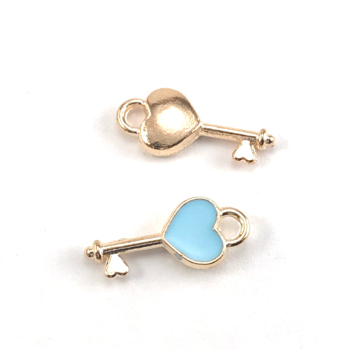 front and back of blue and gold jewelry charms shaped like keys