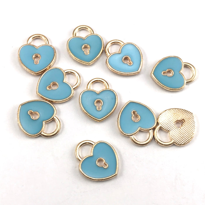 blue and gold jewerly charms that are heart shaped with a key hole