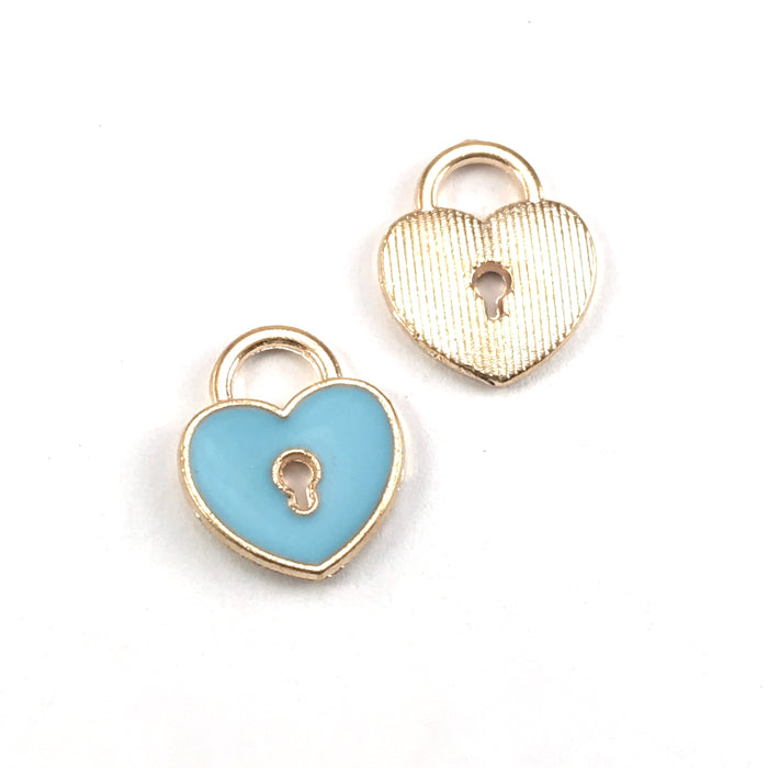 front and back of blue and gold jewerly charms that are heart shaped with a key hole