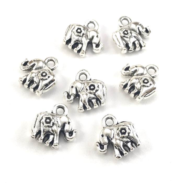 silver colour jewerly charms that look like elephants