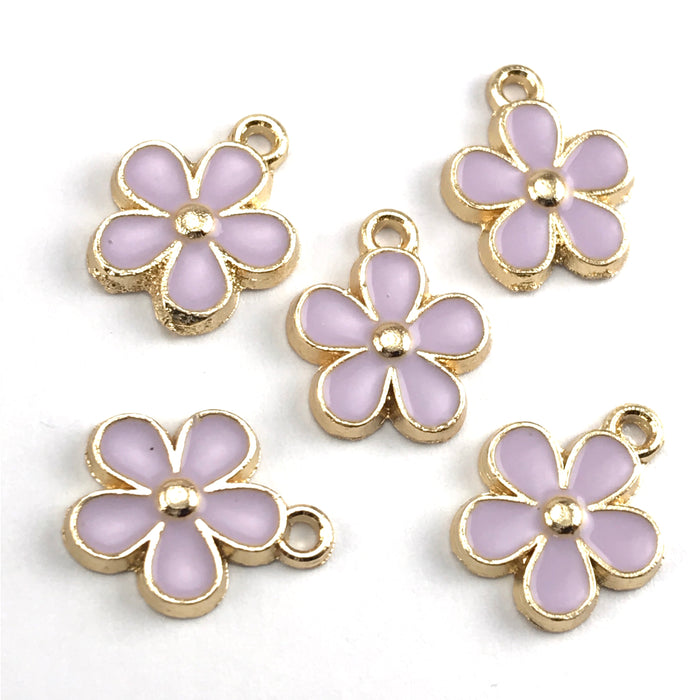 purple and gold colour jewerly charms that look like flowers