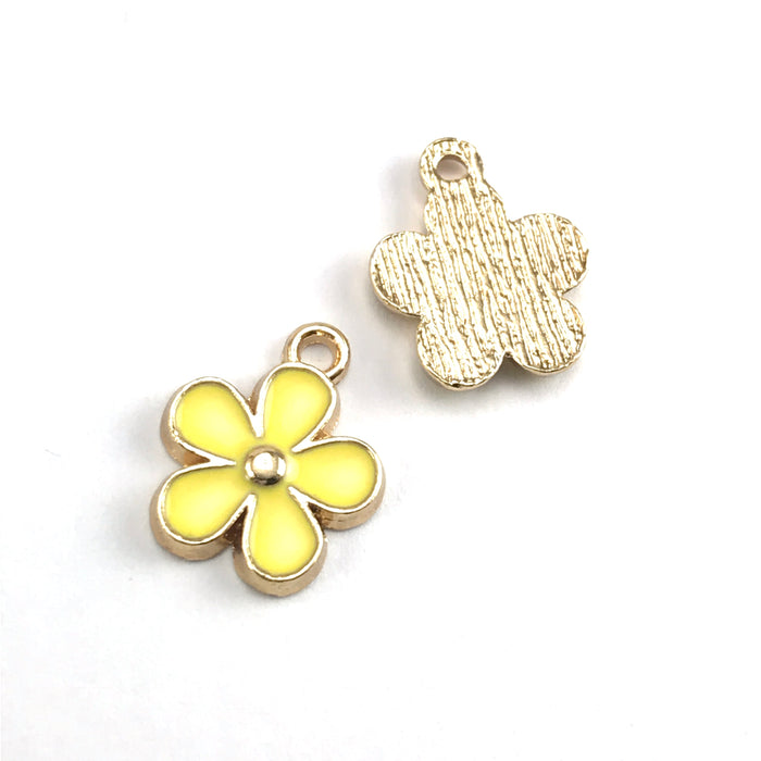 front and back of yellow and gold colour jewerly charms that look like flowers