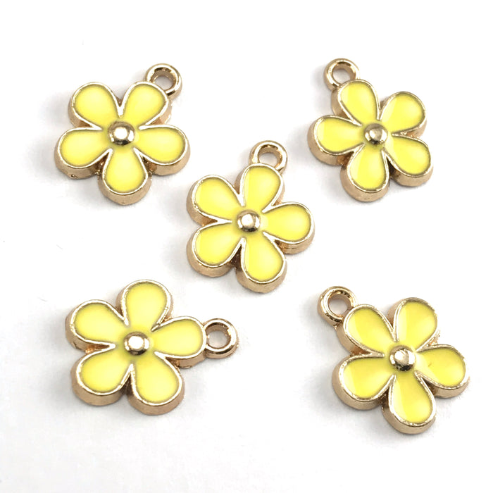 yellow and gold colour jewerly charms that look like flowers
