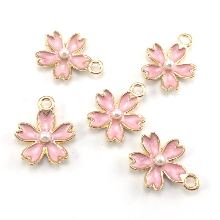 pink and gold colour jewerly charms that look like flowers