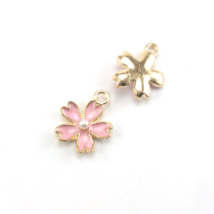 front and back of pink and gold colour jewerly charms that look like flowers