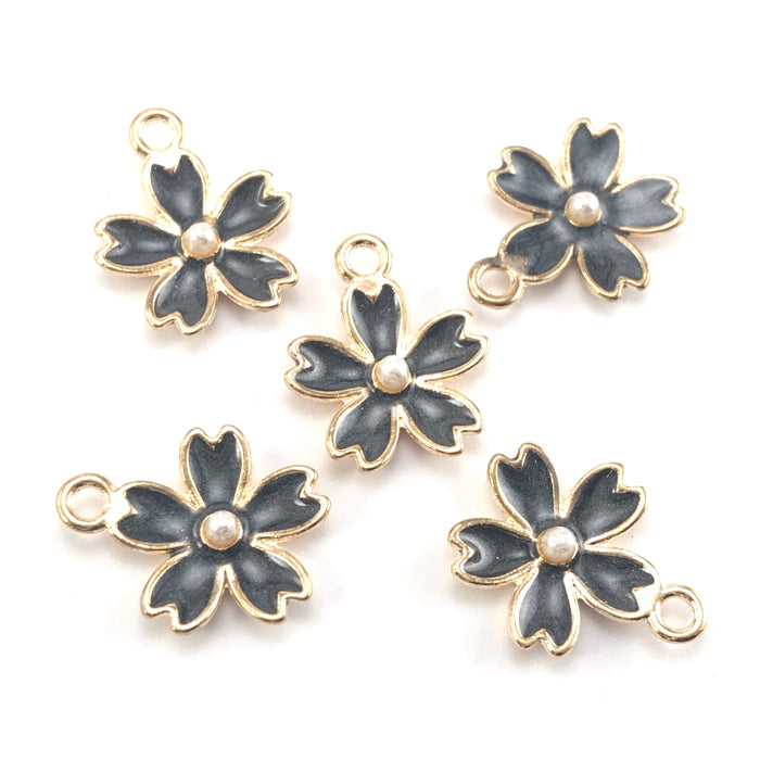 black and gold colour jewerly charms in the shape of flowers