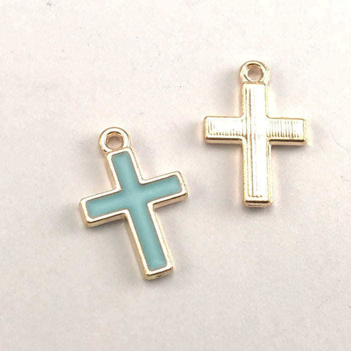 front and back of blue and gold cross shaped jewerly charms