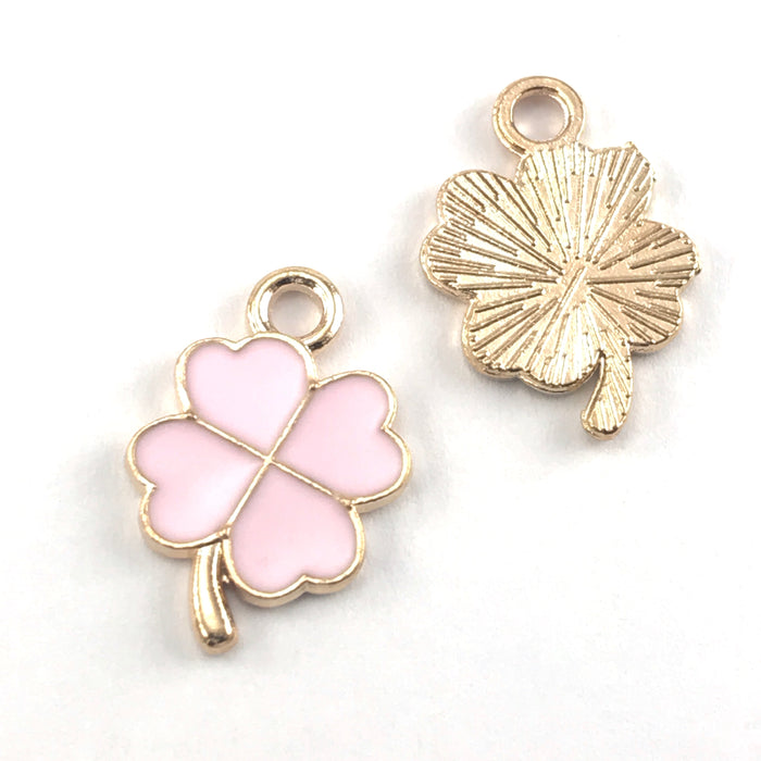 front and back of pink and gold colour jewelry charms that look like four leaf clovers