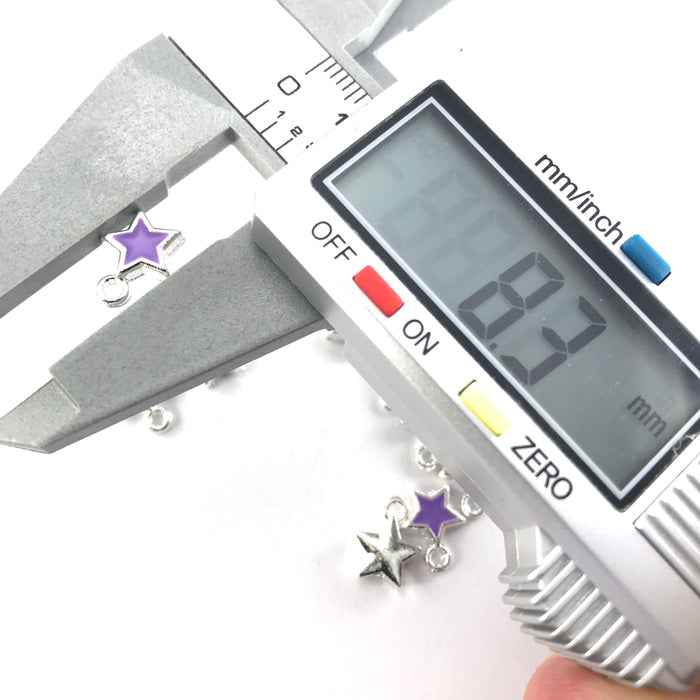 purple and silver star shaped jewerly charms on a digital ruler showing 8.3mm