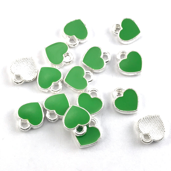 green and silver heart shaped jewerly charms