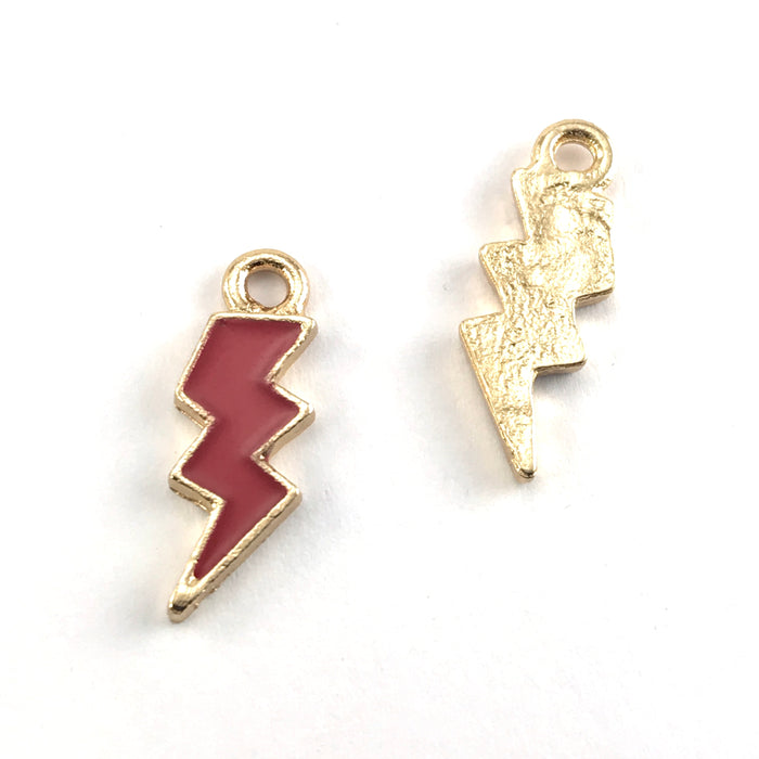 front and back of red and gold lightning shaped jewerly charms