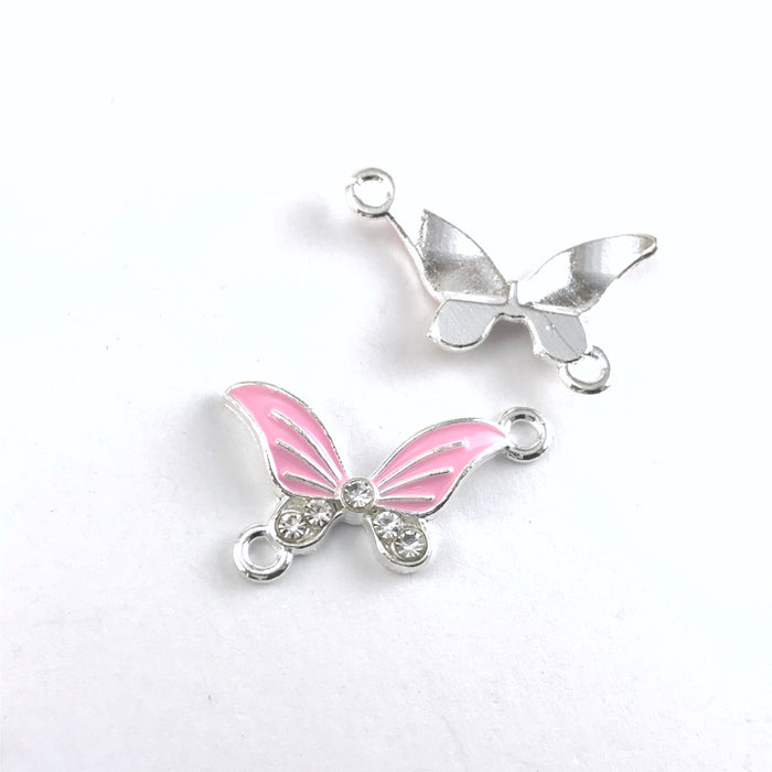 front and back of  pink and silver butterfly shaped jewerly pendants