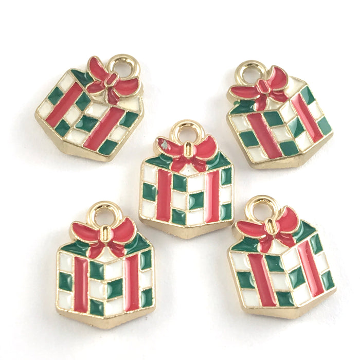 green white and red jewerly charms shapped like wrapped christmas gifts
